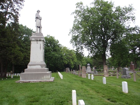 Burial area and Union Soldiers' monument at Mound City Cemetery Soldiers' Lot in Mound City, Kan.