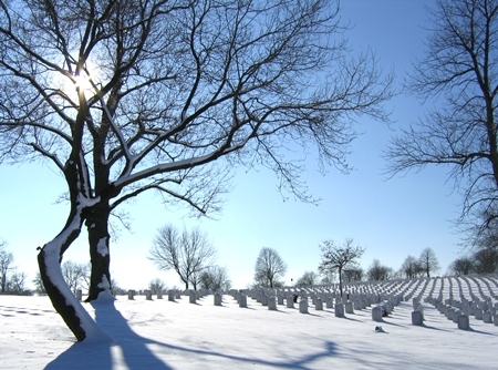 Snow covers headstones at Wood National Cemetery.