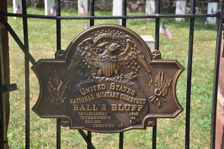Historic plaque on the gate at Balls Bluff National Cemetery.
