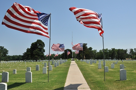Colors wave on Flag Day at Fort Gibson National Cemetery.
