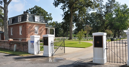 Entrance gate and lodge at Port Hudson National Cemetery.