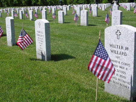 Headstones decorated for Memorial Day at Ohio Western Reserve National Cemetery.