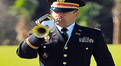 Army bugler plays Taps