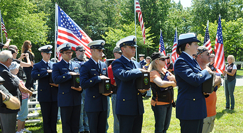 U.S. Coast Guardsmen participate in a Missing In America Project ceremony at Quantico National Cemetery in Triangle, Virginia, June 2013.
