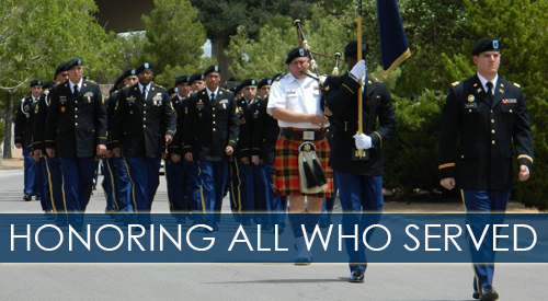Image of a military color guard marching with the flags of the services, under the words,