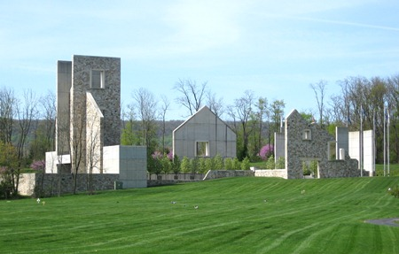 A photo of the Pennsylvania Veterans Memorial. Geometrical shaped stone wall with square sprouting water fountains positioned within the walls.