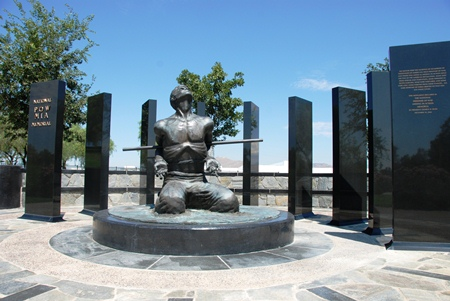 A photo of the Medal of Honor Memorial. Geometrical shaped stone wall with water feature in the center.
