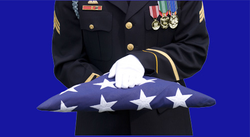 Soldier in Dress Blue Uniform Presenting Burial Flag