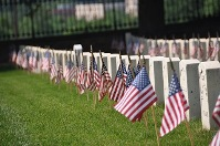 Flags and headstone rows at Loudon Park National Cemetery, Baltimore.