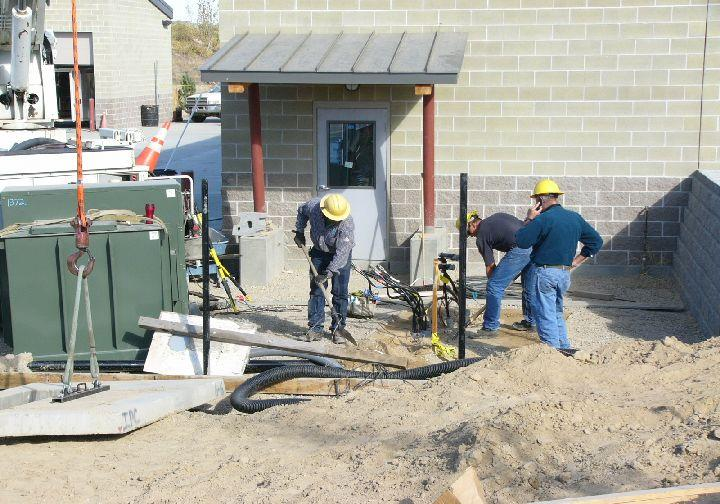 Picture of a workcrew installing electrical lines.